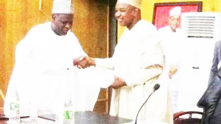 Chairman of NNDC (left) presenting a business plan to Gov. Atiku Bagudu of Kebbi State