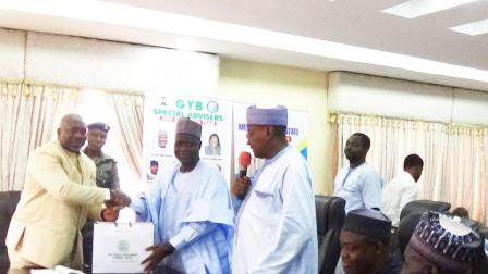 Chairman of NNDC (middle) presenting a business plan to Rt. Hon. Simon Achuba, Deputy Gov. Kogi State