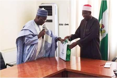 Chairman of NNDC (left) presenting the NNCMC business plan to the Executive Governor of Kano State. Alhaji Abdullahi Ganduje ofr